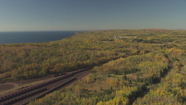ws aerial view of along railway tracks towards two harbors ore dock / minnesota, united states - minnesota stock videos & royalty-free footage