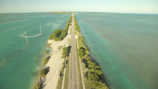 ws aerial view of along route one overseas highway between matecumbe bight and upper matecumbe key / florida, united states - causeway stock videos & royalty-free footage