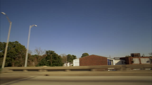 ms pov view of along suburban highway - passenger point of view stock videos & royalty-free footage