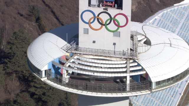 view of alpensia resort (popular tourist destination) observation tower and the olympic emblem in gangwon-do, pyeongchang, south korea - the olympic games stock videos & royalty-free footage