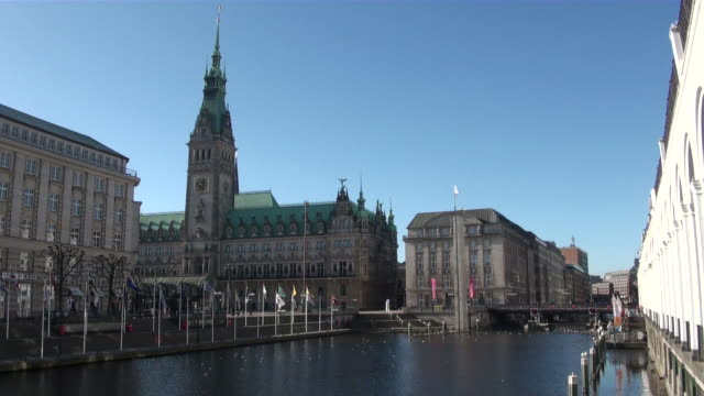 ws view of alsterfleet and city hall building / hamburg, hamburg, germany - rathaus hamburg stock-videos und b-roll-filmmaterial