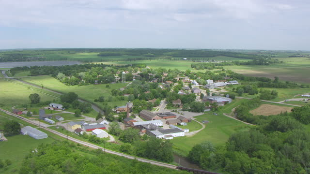 WS AERIAL POV View of Amana Woolen Mill in village / Amana Colonies, Iowa, United States