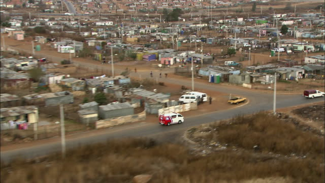 ws ts aerial view of ambulance on street in soweto / johannesburg, gauteng, south africa - soweto stock videos and b-roll footage
