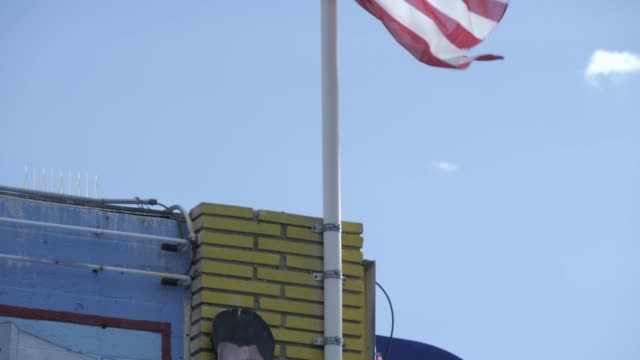 view of american flag and elvis presley banner on the strip, las vegas boulevard, las vegas, nevada, united states of america, north america - male likeness stock videos & royalty-free footage