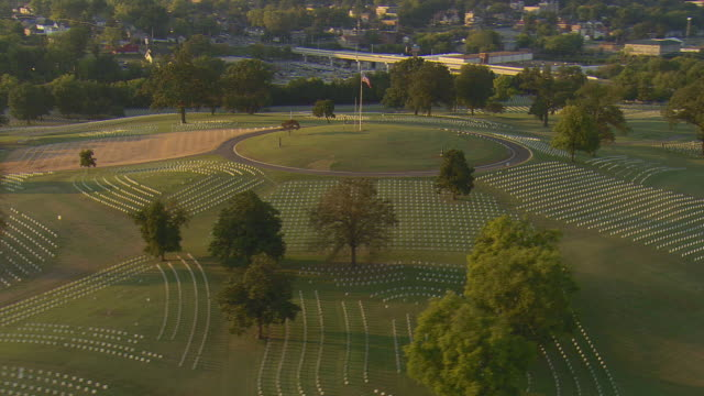 ws aerial view of american flag at chattanooga national cemetary / chattanooga, tennessee, united states  - chattanooga stock videos and b-roll footage