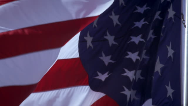 view of american flag close up and flowing in the breeze. - プロボ点の映像素材/bロール