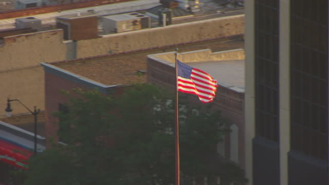 WS DS AERIAL POV View of American flag waving at top of old Capitol building / Springfield, Illinois, United States