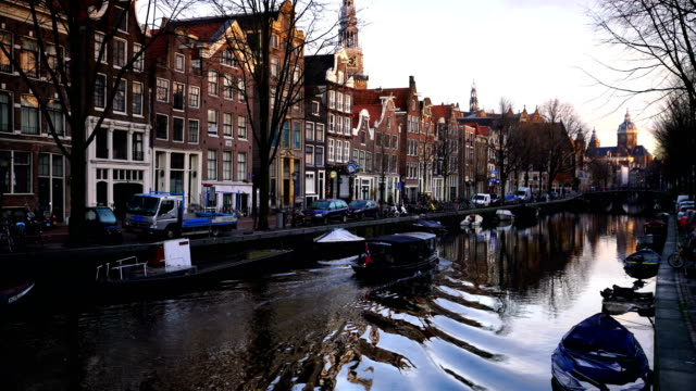 view of amsterdam canals with typical dutch houses - canal stock videos & royalty-free footage