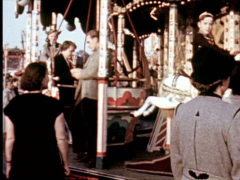 ms view of amusement park rides  audio / germany - 1950 stock-videos und b-roll-filmmaterial