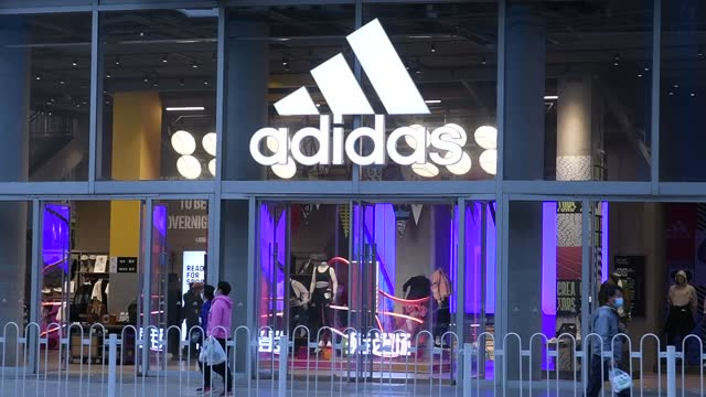 view of an adidas store at wangfujing on march 29, 2021 in beijing, china. - adidas stock videos & royalty-free footage