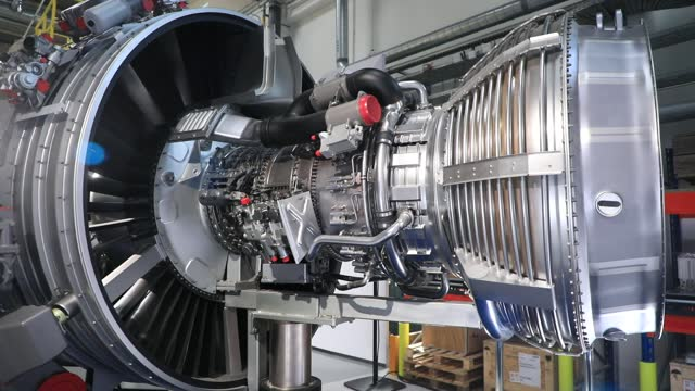 view of an airplane turbine at the entrance of a foundry plant of the aeronautic group safran, which manufactures turbines that are part of the... - engine stock videos & royalty-free footage