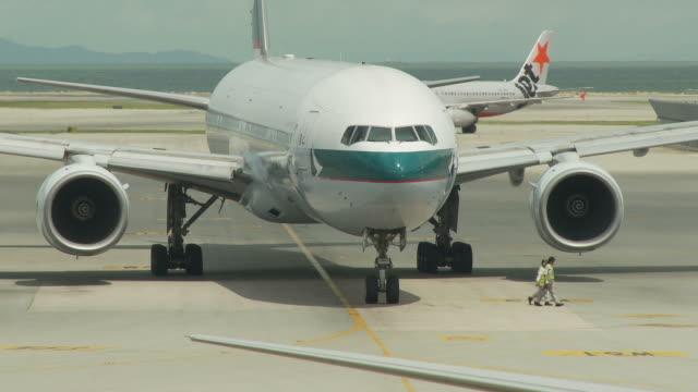 view of an airport in hong kong, china - hong kong international airport stock videos & royalty-free footage