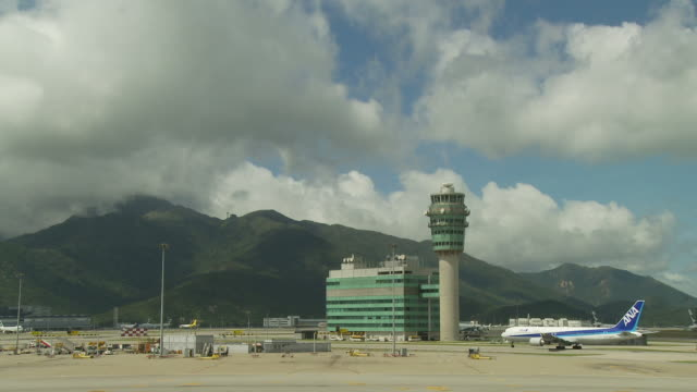 view of an airport in hong kong, china - hong kong international airport stock videos and b-roll footage