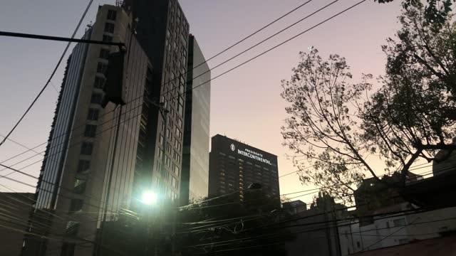 """view of an avenue in the polanco district at dusk, in the background the skyscraper of the prestigious """"presidente intercontinental"""" hotel on... - generic location stock videos & royalty-free footage"""