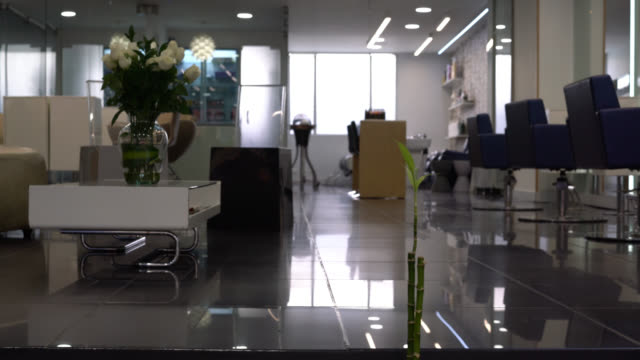 view of an empty beauty salon - no people - hairdresser stock videos & royalty-free footage