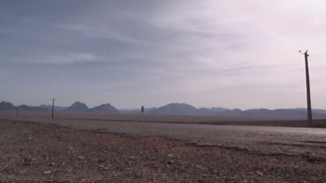 view of an empty desert road in yazd province. - yazd province stock videos & royalty-free footage
