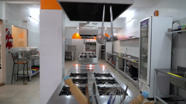 view of an industrial kitchen at a culinary institute - kitchen stock videos & royalty-free footage