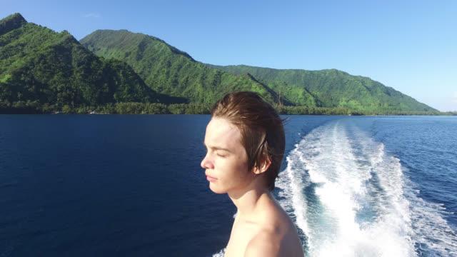 vídeos y material grabado en eventos de stock de view of an island from the sea, portrait of a child - península