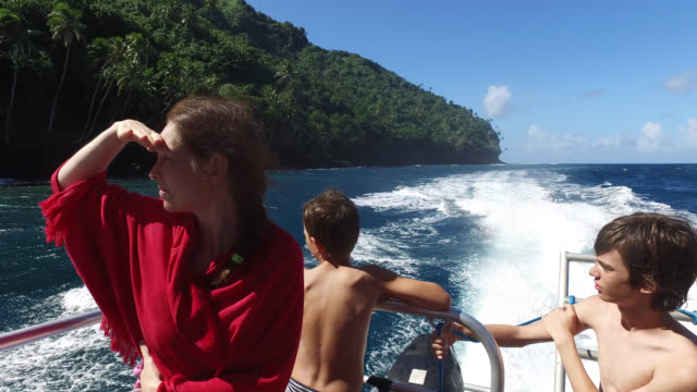 view of an island from the sea, portrait of woman and children - 10歳から11歳点の映像素材/bロール