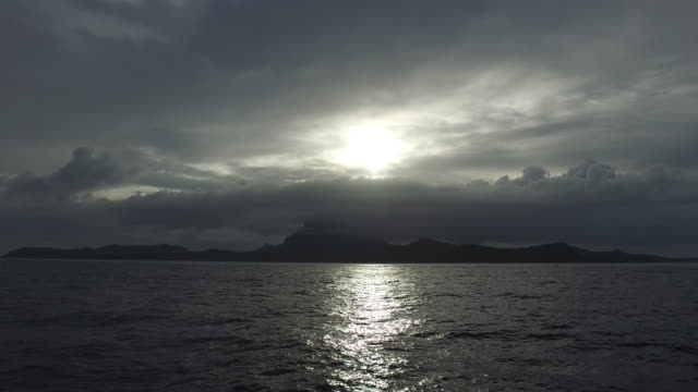 view of an island from the sea - polynesian culture stock videos and b-roll footage