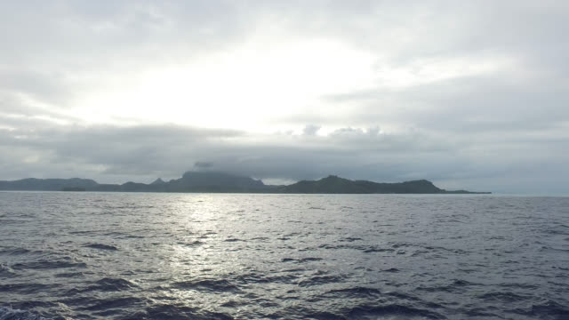 view of an island from the sea - tahitian culture stock videos & royalty-free footage