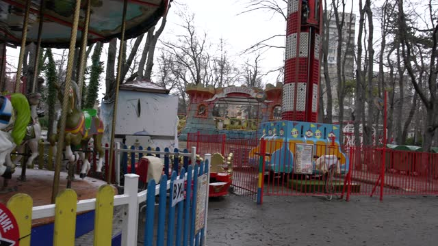 a view of an old amusement park and empty children's playground in a public park - pavel gospodinov stock videos & royalty-free footage