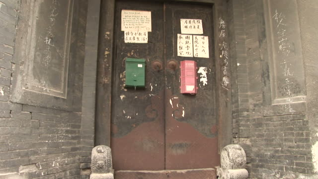 view of an old building in beijing china - hutong alley stock videos & royalty-free footage