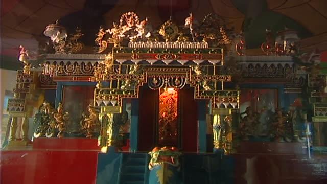 view of an ornately carved threedimensional mandala housing the bodhisattva of compassion avalokiteshavara - three dimensional stock videos & royalty-free footage