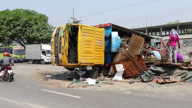 view of an overturned truck on dhakaaricha highway in an accident in dhaka - savar stock videos and b-roll footage