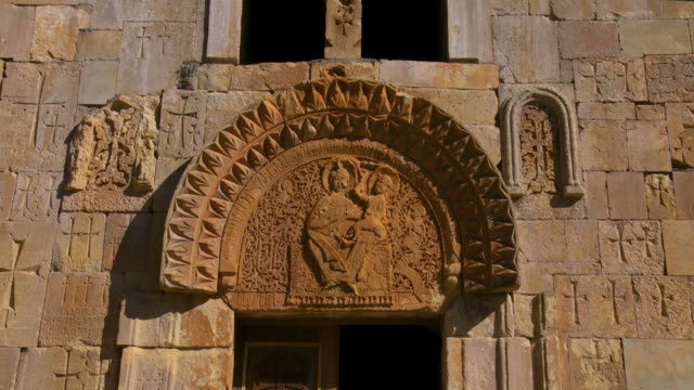 ms view of ancient carvings and sculptures on wall of monastery / armenia - eastern european culture stock videos & royalty-free footage