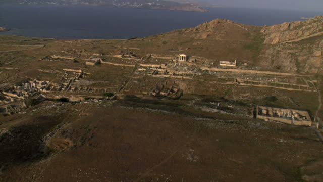 WS AERIAL View of ancient ruins and Excavations in Island Delos / Delos, Cyclades Islands, Greece