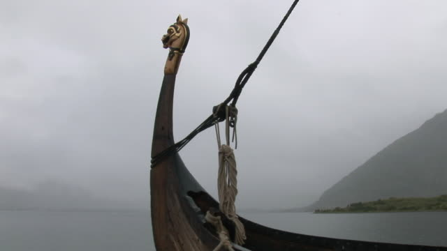 ws view of ancient viking sailing ship and bow / lofoten islands / viking museum, norway - viking stock videos and b-roll footage