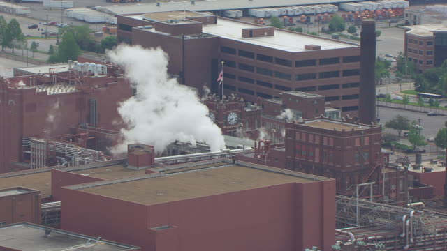 WS AERIAL View of Anheuser Busch brewery with billowing smoke / St Louis, Missouri, United States
