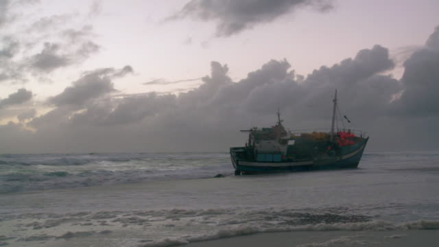 ws pan view of another beached ship / cape town, western cape, south africa - coastal feature stock videos & royalty-free footage