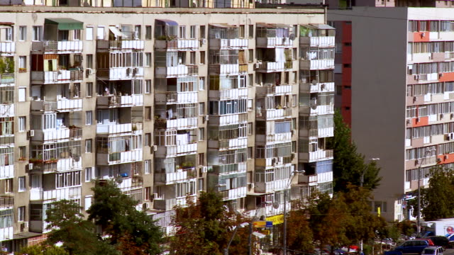 ms pan view of apartment building / bucharest, romania - comunismo video stock e b–roll