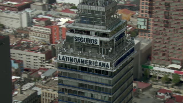 view of apex of the latin american tower in mexico city.. - torre latinoamericana stock videos & royalty-free footage