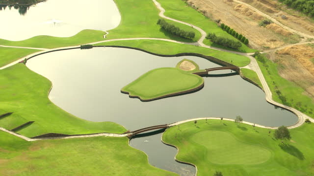 WS AERIAL ZO View of apple shaped island at Apple Tree Golf Course in Yakima river valley / Washington, United States
