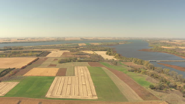 WS AERIAL View of approach lake surrounding by agricultural fields in Lac Qui Parle State Park / Minnesota, United States