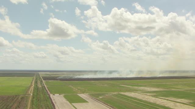 WS AERIAL View of approach sugar cane burn / Lake Okeechobee, Florida, United States