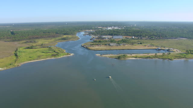 ws aerial view of approach water inlet in mobile county / bayou la batre, alabama, united states - inlet stock videos & royalty-free footage