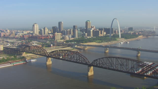 WS AERIAL View of approaching downtown from southeast over Mississippi River and toward highway 40 bridge / St Louis, Missouri, United States