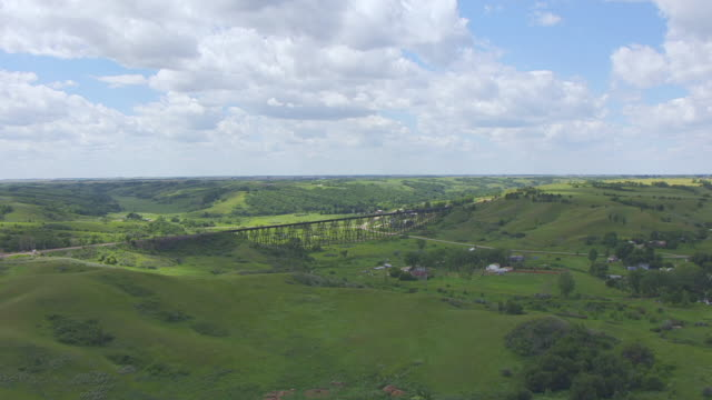 WS AERIAL TS View of Approaching Gasman Coulee Railroad Trestle and circle around trestle / Minot, North Dakota, United States