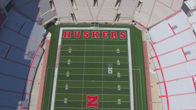 WS AERIAL View of Approaching University of Nebraska Memorial Stadium and fly over stadium / Lincoln, Nebraska, United States