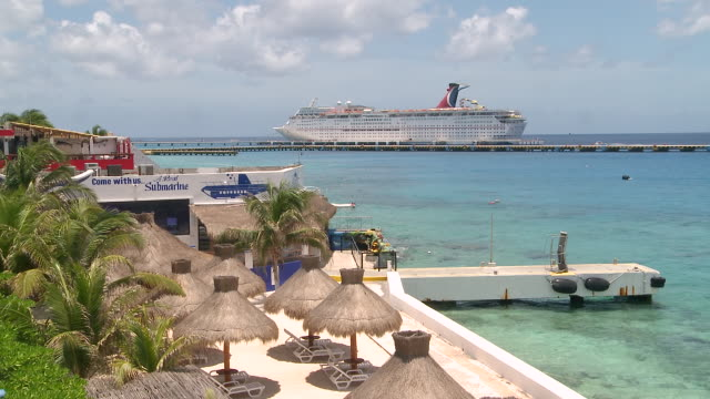 ws view of aquatic sport center with cruise ship  / cozumel, quintana roo, mexico - quintana roo stock videos and b-roll footage