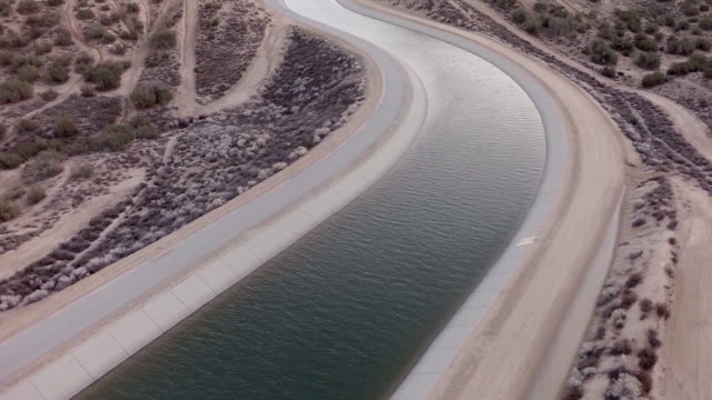 ws aerial view of aqueduct in desert - canal stock videos & royalty-free footage