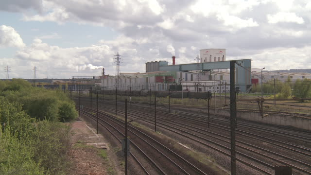 ws view of arcelor mittal factory and tracks / uckange, lorraine, france - lorraine stock videos & royalty-free footage