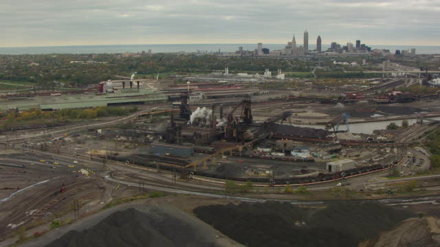 ws aerial view of arcelor mittal steel factory with downtown / cleveland, ohio, united states - cleveland stock videos and b-roll footage