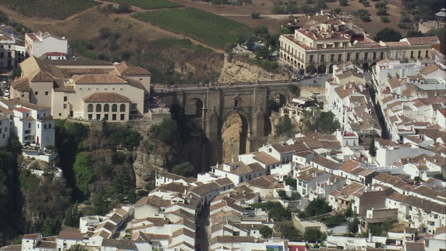 ws pov aerial view of arch bridge at ronda / andalusia, spain - arch bridge stock videos & royalty-free footage
