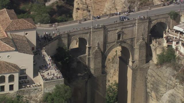 ws zo aerial view of arch bridge at ronda / andalusia, spain - arch bridge stock videos & royalty-free footage