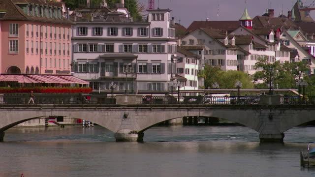 ws view of arch bridge on limmat river / zurich, switzerland  - arch bridge stock videos & royalty-free footage